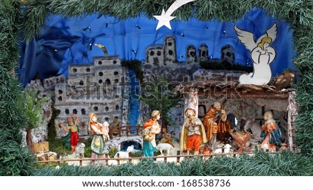 Nativity scene with statues in classical model with pastors and the Manger - stock photo
