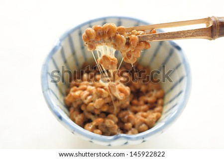 Natto, fermented soybeans on white background - stock photo