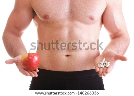 natural apple vitamin or pill drag tablet Man isolated offering pill in one and pills in bottle - in another hand. Copy space boxes with supplements