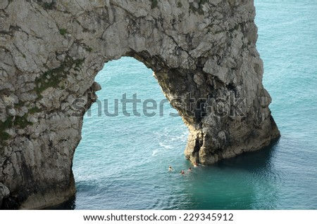 Natural arch at Durdle Door on Dorset Coast - stock photo