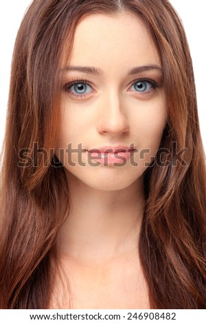 Natural as she is. Close up Portrait of beautiful young woman looking at camera while standing against white background - stock photo