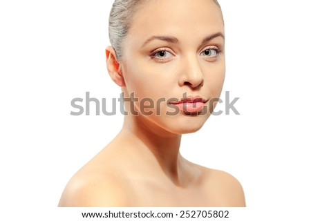 Natural as she is. Portrait of beautiful young caucasian shirtless woman looking at camera while standing against white background