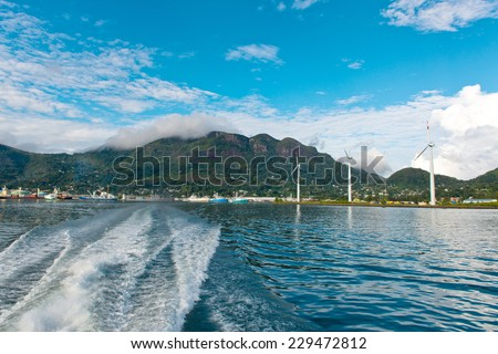 Natural Attraction of Beautiful Turquoise Sea Water at Victoria Seychelles with Large Green Mountains View Afar. - stock photo