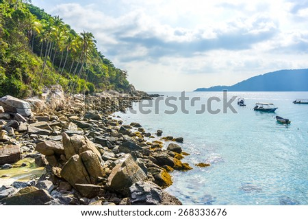 natural back light seascape and fishing boat - stock photo
