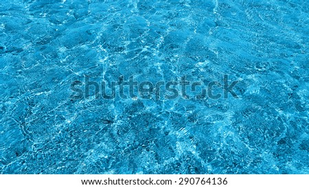 Natural background of transparent blue sea water - stock photo