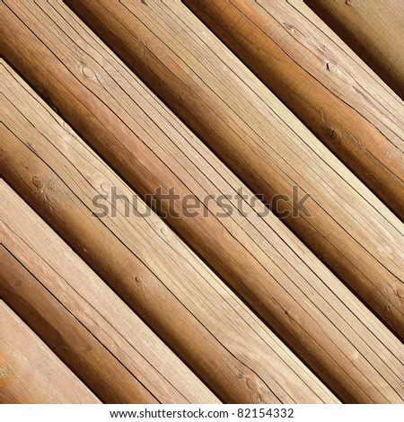 Natural background pattern of a log wall - stock photo