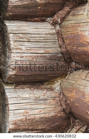 Natural background pattern of a log wall. Detail of wooden wall joint - traditional lodge - stock photo