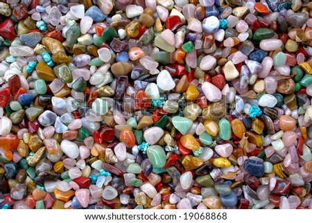 natural background - shiny multi coloured semi precious gem stones (for design, craftsmanship, gift) - stock photo