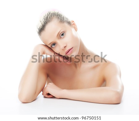 Natural beauty - beautiful face of young pretty woman with clean smooth skin - stock photo
