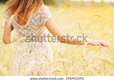 Natural beauty. Beautiful girl in a wheat field - stock photo