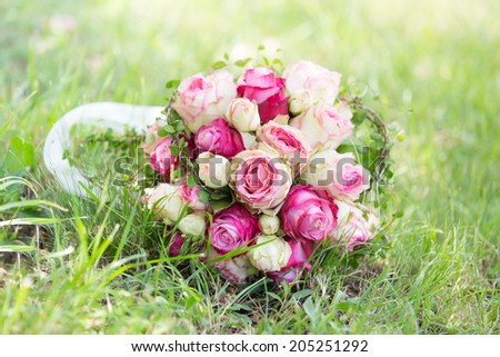 Natural bouquet of wedding flowers in pink - stock photo