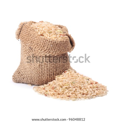 Natural brown rice in small burlap sack