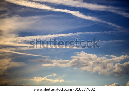 Natural color aerial overcast beautiful wallpaper background with bright blue open sky full of many small white clouds different shapes, horizontal picture - stock photo