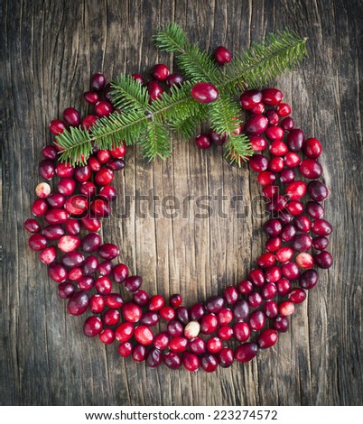 Natural Cranberries Wreath on Wooden Background. Toned image. - stock photo