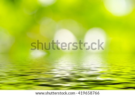 Natural defocus green background reflect with water , the bokeh effect - stock photo