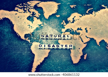 NATURAL DISASTER on white cube, vintage - stock photo