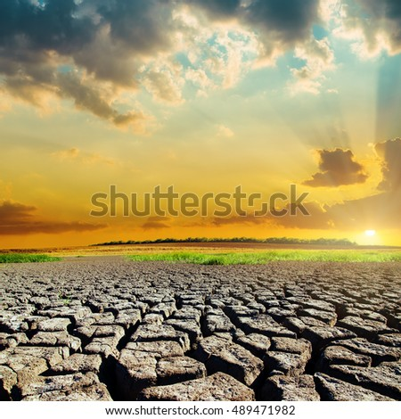 natural disaster with drought earth and sunset over it