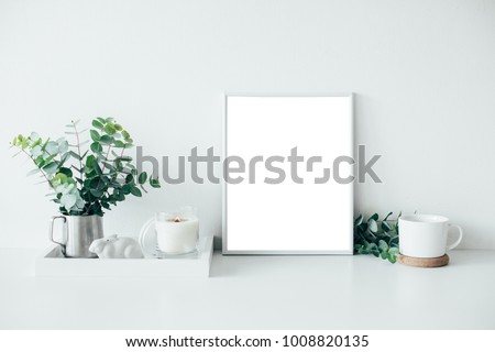 Natural eco home decor with green leaves, poster mock-up and bur