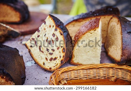 Natural european hand made bread. Black bread. Baked bread servings on wooden board made using ancient bakery methods