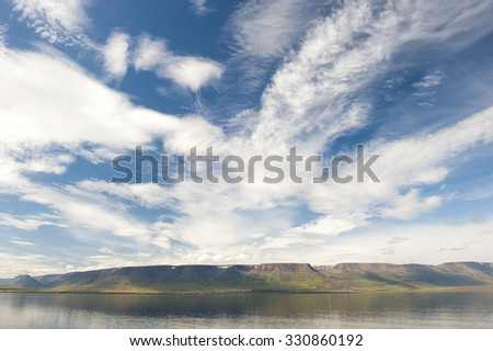 Natural fjord landscape with mountains and clouds, polar filter, Akureyri, iceland - stock photo