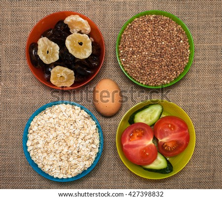 Natural food. Rice, vegetables, fruits and egg. - stock photo