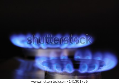 Natural gas burning with blue clean flames - stock photo