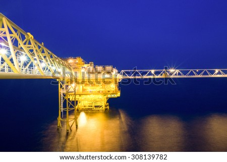 Natural gas field in twilight - stock photo