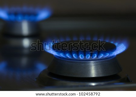 Natural gas flames from the household cooker - stock photo