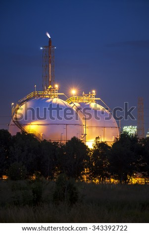Natural Gas Industrial storage sphere tanks in twilight - stock photo