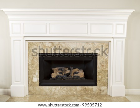 Natural gas insert fireplace with large mantel - stock photo