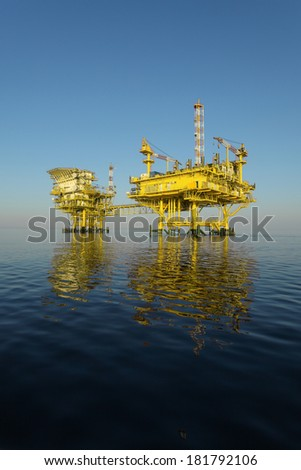 Natural gas platform on calm blue sea - stock photo