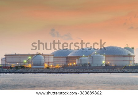 Natural gas tank and oil tank in evening - stock photo