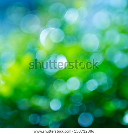 natural green background with bokeh circles. - stock photo