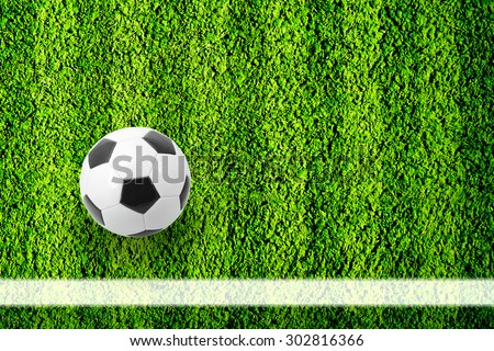 Natural green football field background with ball near the line - stock photo
