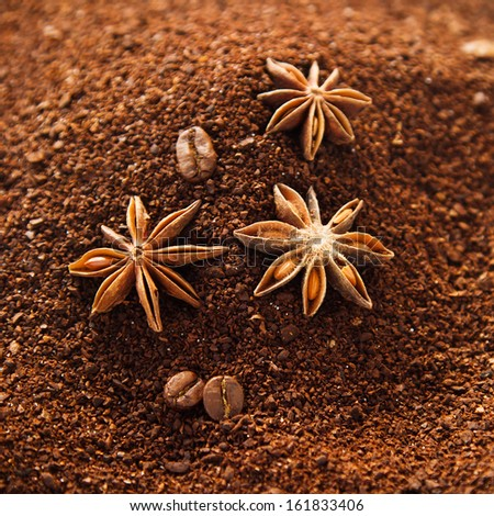 Natural ground coffee background with star anise, coffee beans and some spilled sugar - stock photo