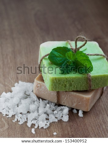 Natural handmade Herbal Soap with green mint  leaves - stock photo