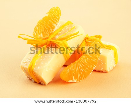Natural handmade soap and orange, on beige background - stock photo