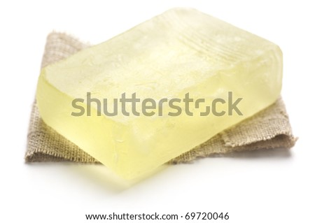 Natural handmade soap with piece of linen isolated on white background.