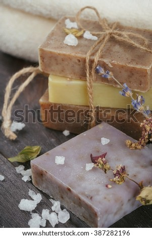 Natural handmade soaps with salt, coffee beans, cinnamon, anise star and dried lavender flowers