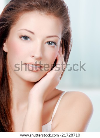 Natural health beauty  of a woman face - colored background