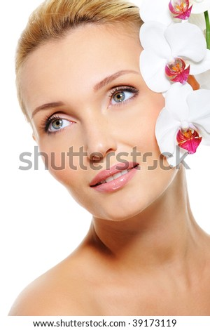 Natural healthy female skin and beautiful white orchid flower - stock photo