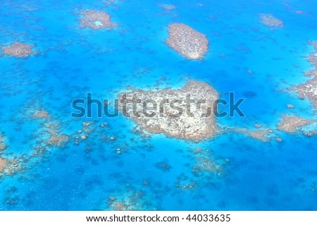Natural heart shaped coral island in Great Barrier Reef near Cairns, Australia seen from above - stock photo
