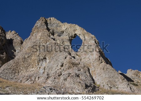 Natural holes limestone rock in the mountains