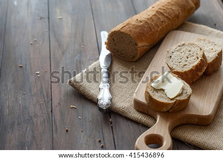 Natural homemade seeds and buckwheat bread on the wooden Board - stock photo