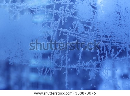 Natural ice pattern on winter glass - stock photo