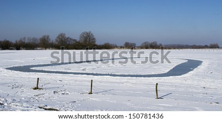 Natural ice track in the countryside in the Netherlands - stock photo