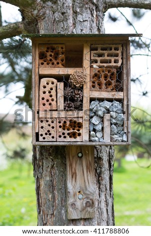 Natural insect hotel in the forest - stock photo