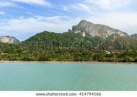 Natural landscape. Island,  blue sky and ocean - stock photo