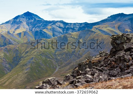Natural landscape of fall colored alpine tundra wilderness habitat in high mountain range of Tombstone Mountains, Yukon Territory, Canada