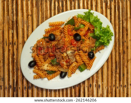 Natural light photo of macaroni pasta with bolognese sauce and parmesan cheese on a white plate top view 1 - stock photo